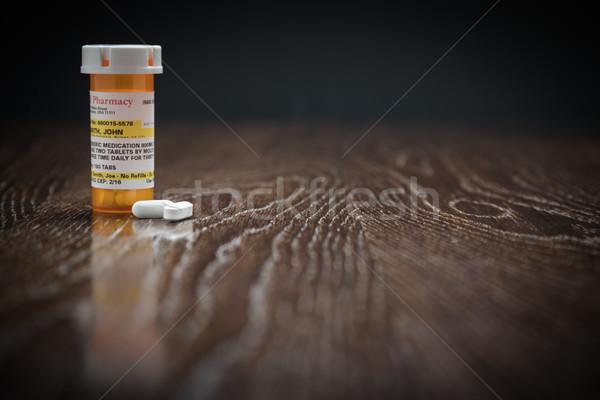 Bottiglia pillole legno superficie Foto d'archivio © feverpitch