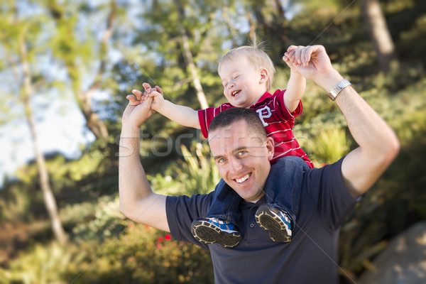 Young Laughing Father and Child Piggy Back Stock photo © feverpitch