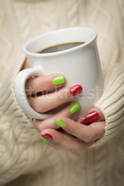 Woman with Red and Green Nail Polish Holding Cup of Coffee Stock photo © feverpitch