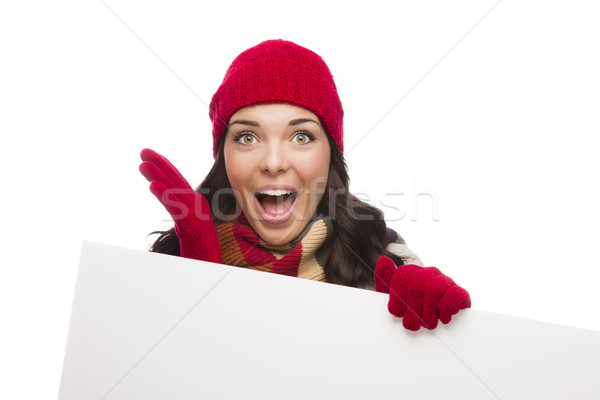 Surprised Girl Wearing Winter Hat and Gloves Holds Blank Sign  Stock photo © feverpitch
