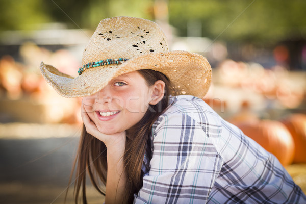 Pretty Preteen Girl Portrait at the Pumpkin Patch Stock photo © feverpitch