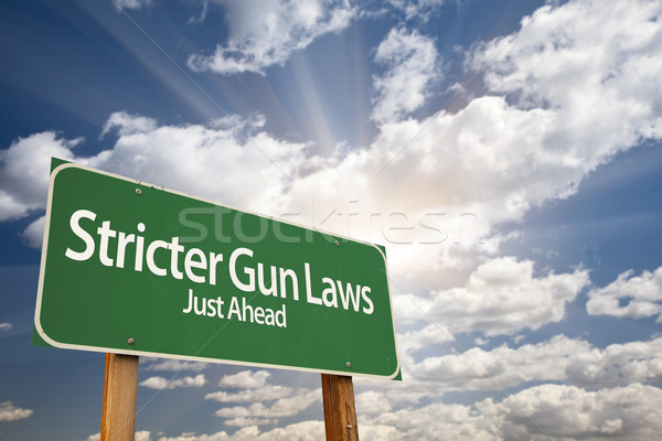 Stricter Gun Laws Green Road Sign Over Clouds Stock photo © feverpitch