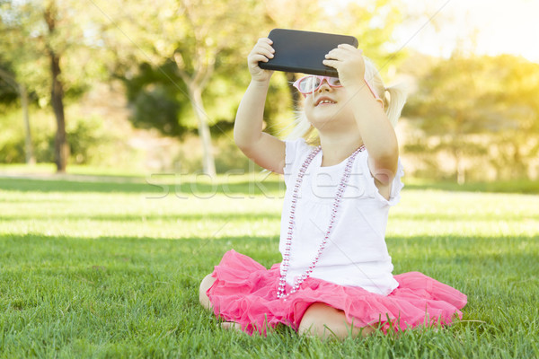 Stock photo: Little Girl In Grass Taking Selfie With Cell Phone