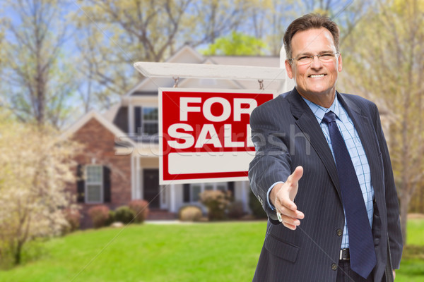 Male Agent Reaching for Hand Shake in Front of House and For Sal Stock photo © feverpitch