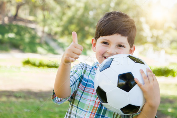 Cute Young Boy Playing with Soccer Ball and Thumbs Up Outdoors i Stock photo © feverpitch
