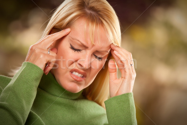 Grimacing Woman Suffering a Headache Stock photo © feverpitch