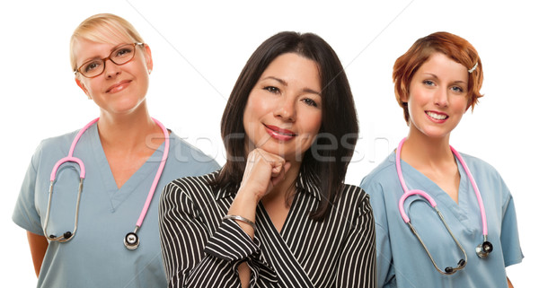 Hispanic Woman with Female Doctors and Nurses Stock photo © feverpitch