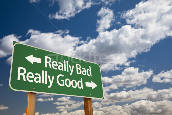 Really Bad, Really Good Green Road Sign and Clouds Stock photo © feverpitch