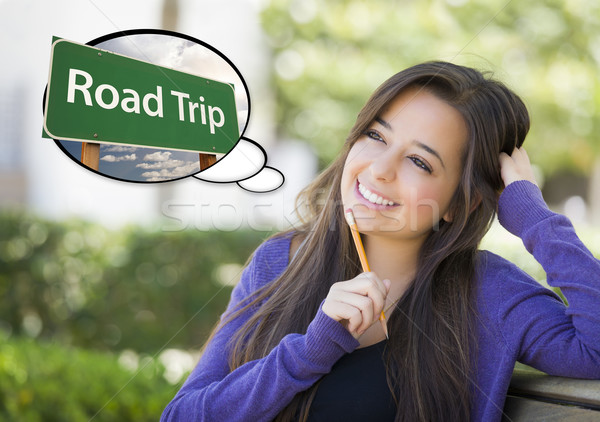 Stock photo: Young Woman with Thought Bubble of Road Trips Green Sign