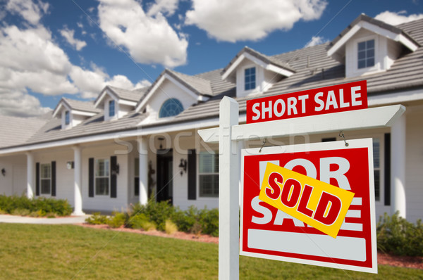 Stock photo: Sold Short Sale Real Estate Sign and House - Right