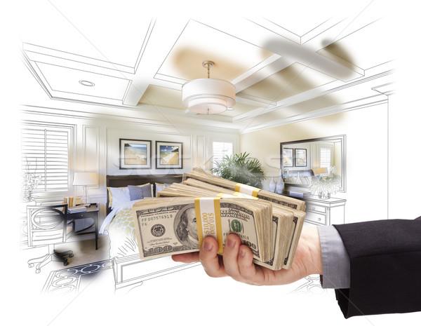 Handing Stack of Money Over Bedroom Drawing Photograph Combinati Stock photo © feverpitch