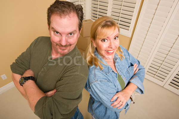 Goofy Couple and Moving Boxes in Empty Room Stock photo © feverpitch