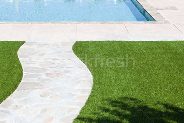 New Artificial Grass Installed Near Walkway and Pool. Stock photo © feverpitch
