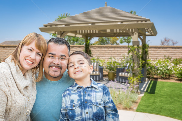 Mixed Race Family In Back Yard Near Patio Cover. Stock photo © feverpitch