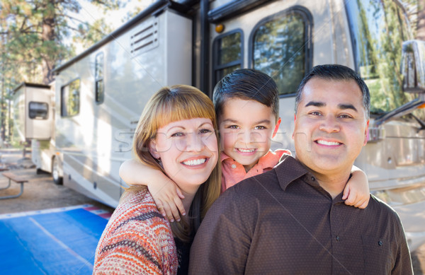 Happy Young Mixed Race Family In Front of Their Beautiful RV At  Stock photo © feverpitch