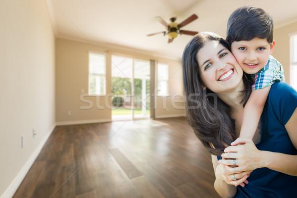 Jóvenes madre hijo dentro habitación vacía madera Foto stock © feverpitch