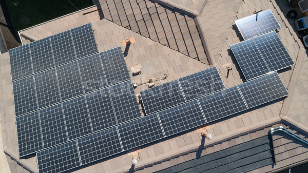 Solar Panels Installed on Roof of Large House Stock photo © feverpitch