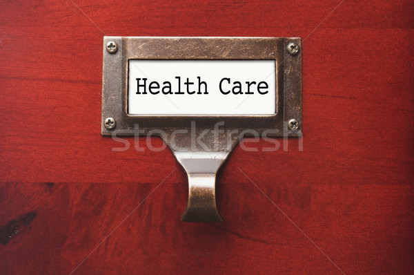 Stock photo: Lustrous Wooden Cabinet with Health Care File Label