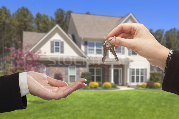 Stock photo: Agent Handing Over the House Keys in Front of New Home