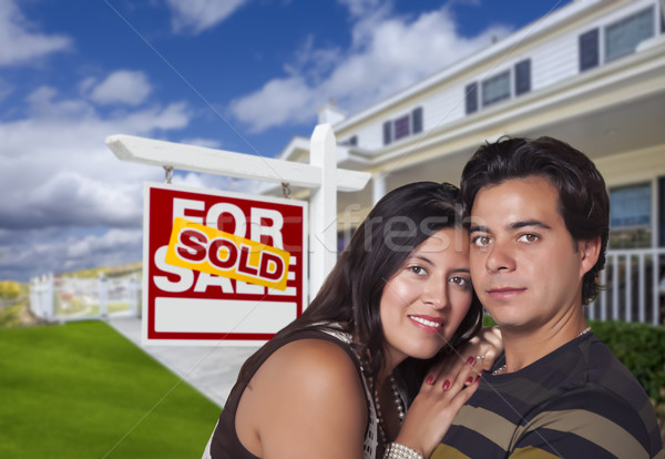 Hispanic Couple, New Home and Sold Real Estate Sign Stock photo © feverpitch