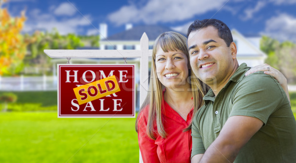 Couple in Front of Sold Real Estate Sign and House Stock photo © feverpitch