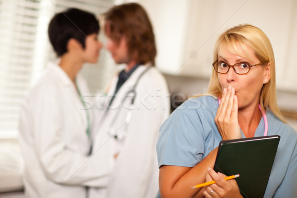 Alarmed Medical Woman Witnesses Colleagues Inner Office Romance Stock photo © feverpitch