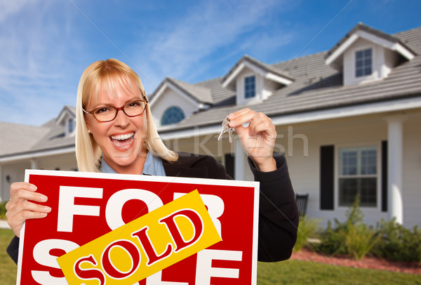 Beautiful Female Holding Keys & Sold Real Estate Sign Stock photo © feverpitch