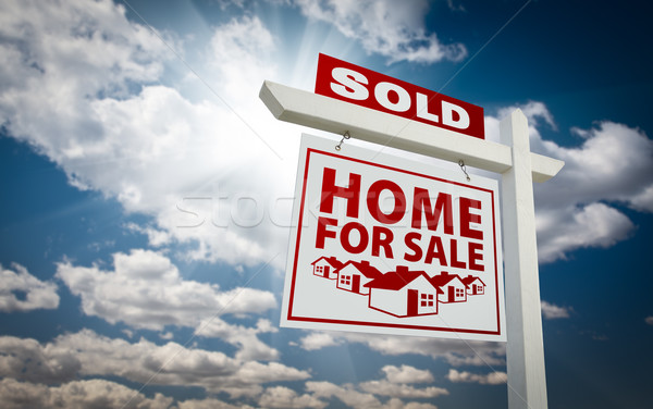 White and Red Sold Home for Sale Real Estate Sign Over Clouds an Stock photo © feverpitch