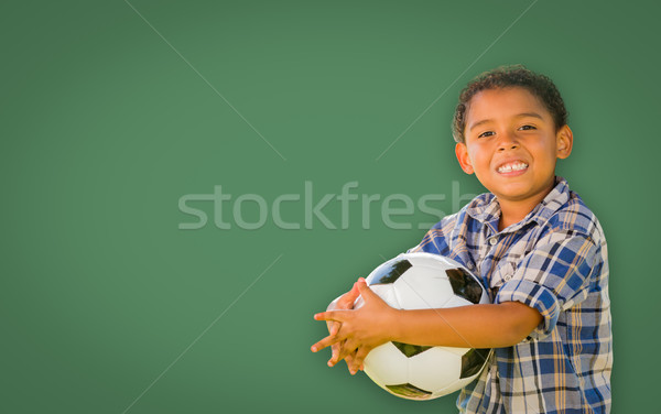 Cute Young Mixed Race Boy Holding Soccer Ball In Front of Blank  Stock photo © feverpitch