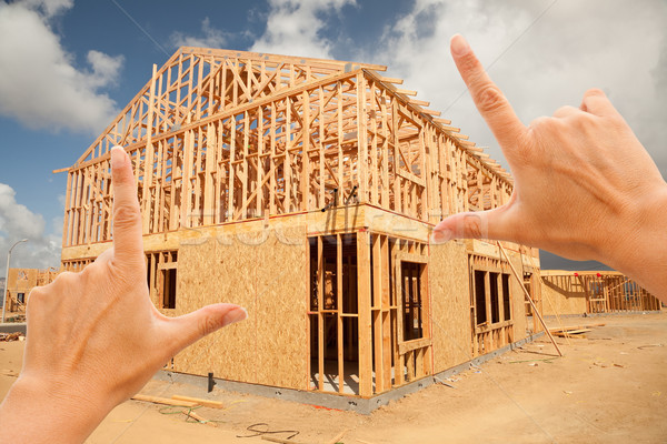 Female Hands Framing Home Frame on Construction Site Stock photo © feverpitch