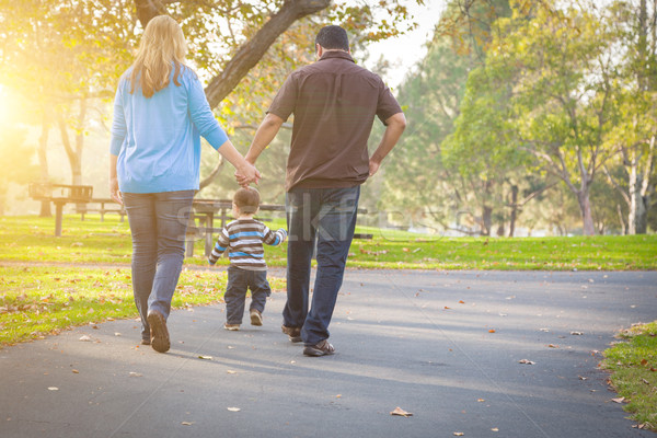 Stock photo: Happy Mixed Race Ethnic Family Walking In The Park