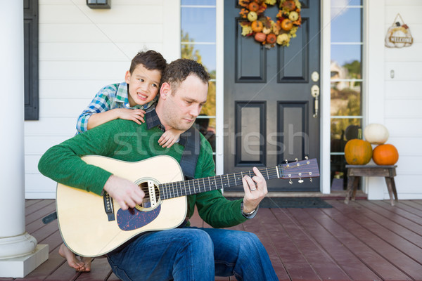 Young Mixed Race Chinese and Caucasian Son Singing Songs and Pla Stock photo © feverpitch