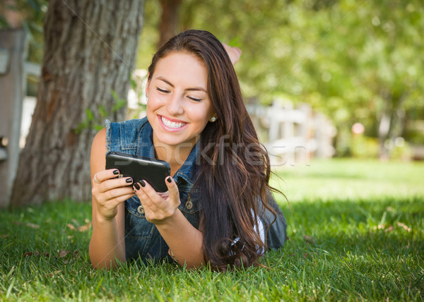 Stock photo: Attractive Happy Mixed Race Young Female Texting on Her Cell Pho