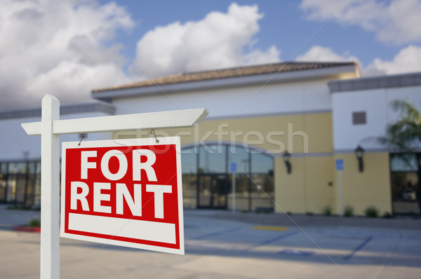 Vacant Retail Building with For Rent Real Estate Sign Stock photo © feverpitch