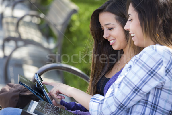 Two Mixed Race Students Using Touch Pad Computer Outside Stock photo © feverpitch