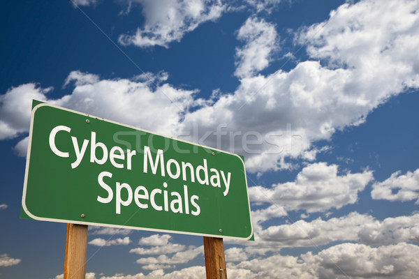 Cyber Monday Specials Green Road Sign and Clouds Stock photo © feverpitch