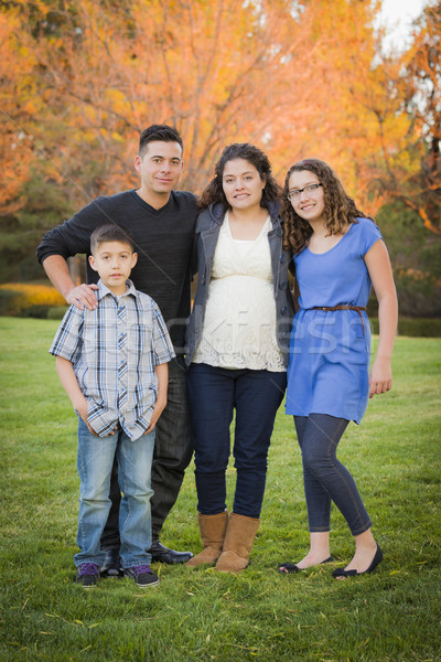 Attractive Hispanic Family Portrait in a Colorful Fall Outdoor S Stock photo © feverpitch