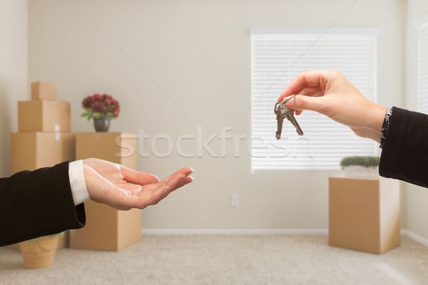 Handing Over House Keys In Room with Packed Moving Boxes Stock photo © feverpitch