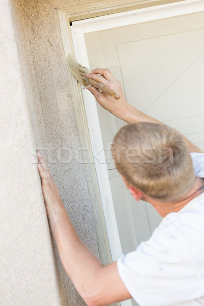 Professional Painter Cutting In With Brush to Paint Garage Door  Stock photo © feverpitch
