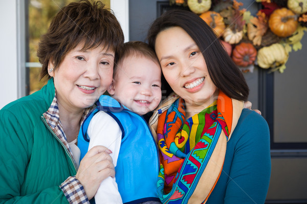 Happy Chinese Senior Adult Grandmother with Her Daughter and Gra Stock photo © feverpitch