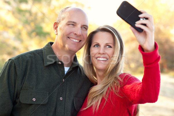 Attractive Couple Pose for a Self Portrait Outdoors Stock photo © feverpitch