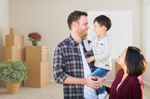Young Mixed Race Caucasian and Chinese Family Inside Empty Room  Stock photo © feverpitch