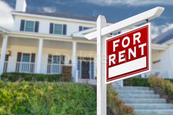 Right Facing For Rent Real Estate Sign In Front of House. Stock photo © feverpitch