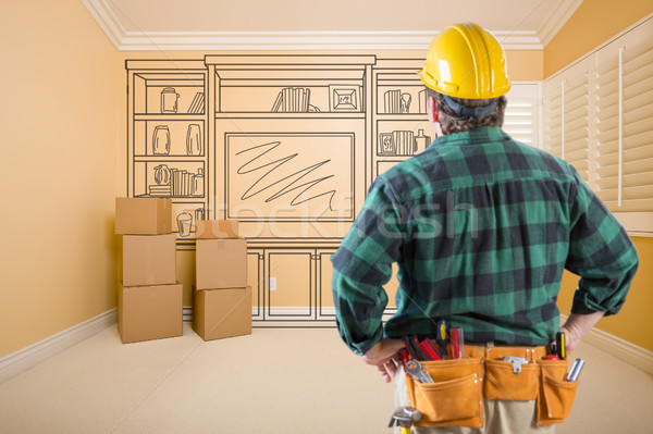 Contractor Standing Indoors with Moving Boxes Looking At Line Dr Stock photo © feverpitch