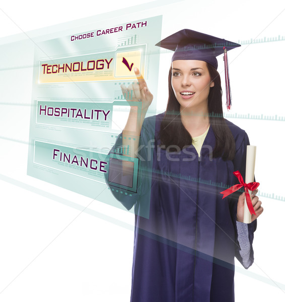 Young Female Graduate Choosing Technology Button on Translucent  Stock photo © feverpitch