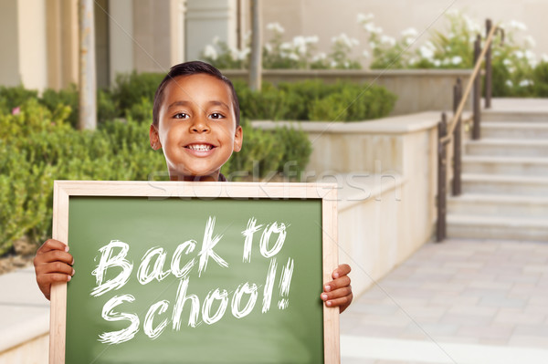 Boy Holding Back To School Chalk Board on School Campus Stock photo © feverpitch