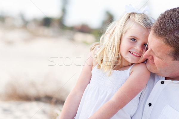 Cute Daughter Cuddles up with Her at the Beach Stock photo © feverpitch