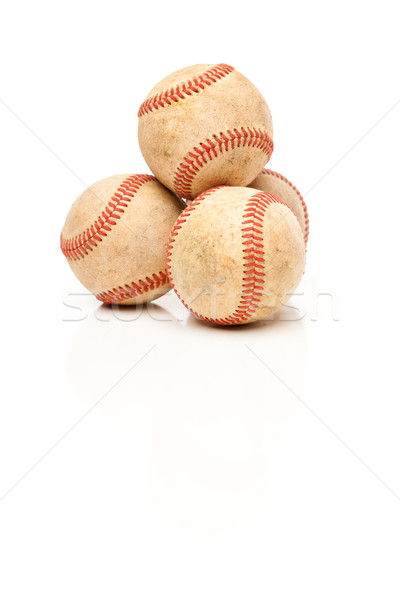 Four Baseballs Isolated on Reflective White Stock photo © feverpitch