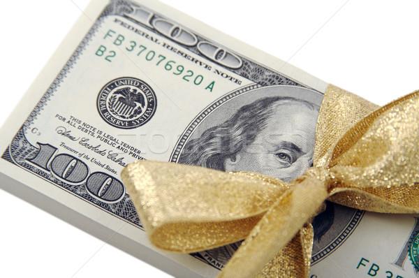 Egy száz dollár bankjegyek arany szalag pénz Stock fotó © feverpitch
