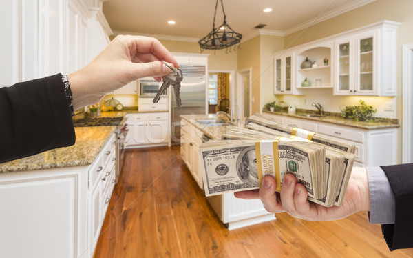 Handing Over Cash for Keys Inside Beautiful Kitchen Stock photo © feverpitch
